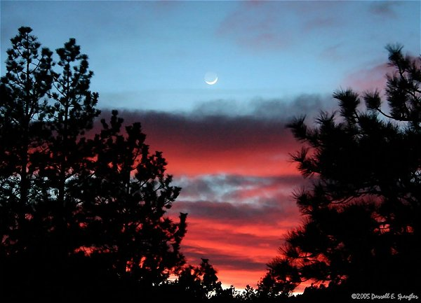 Moon and Earthshine against spectacular Colorado sunset